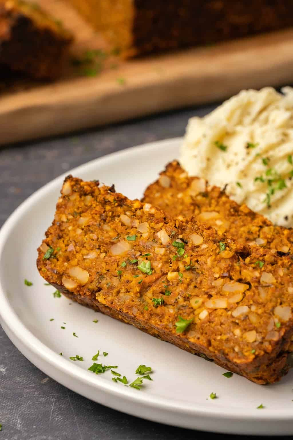 Slices of nut roast on a white plate.