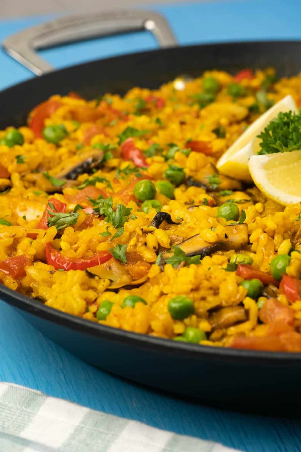 Vegan paella in a black paella pan.