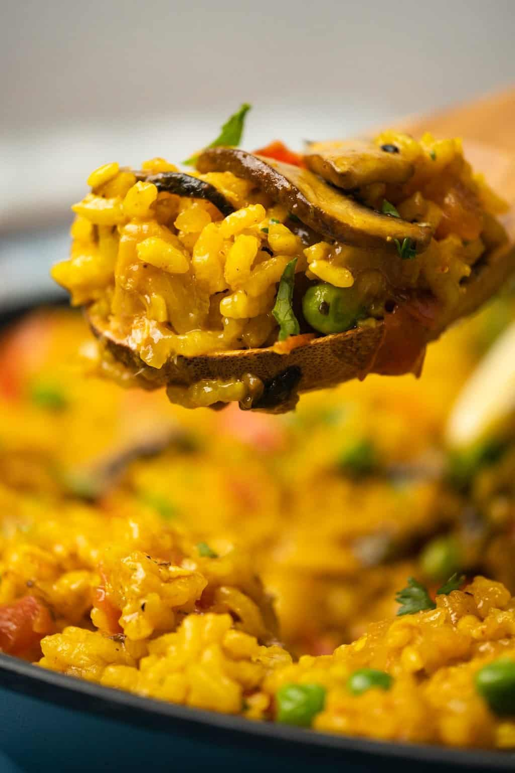 Serving spoon of vegan paella.