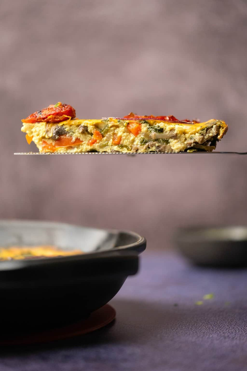 Slice of vegan frittata on a cake lifter.