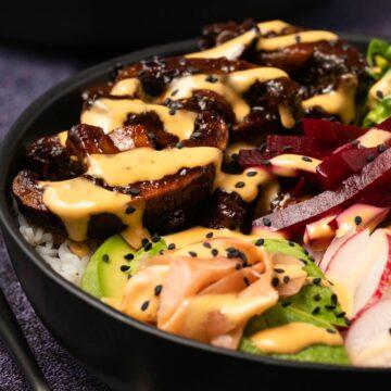 Vegan poke bowl in a black bowl.