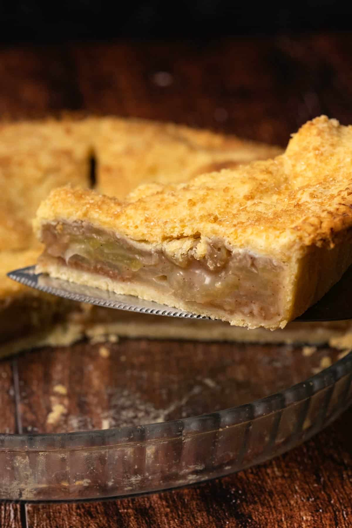 Slice of apple pie on a cake lifter.