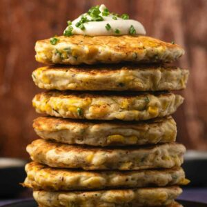 Vegan corn fritters in a stack