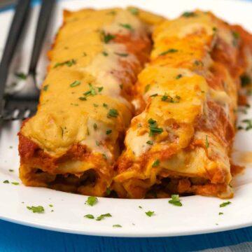 Vegan enchiladas on a white plate.