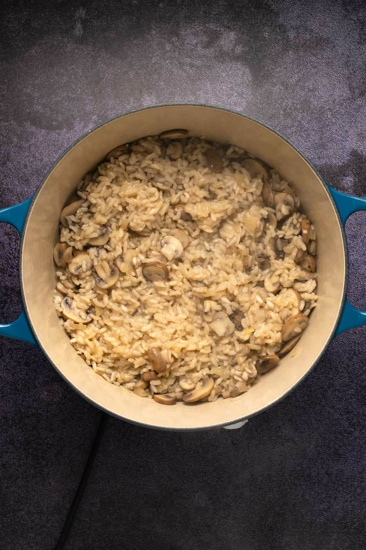 Mushroom risotto cooking in a pot.
