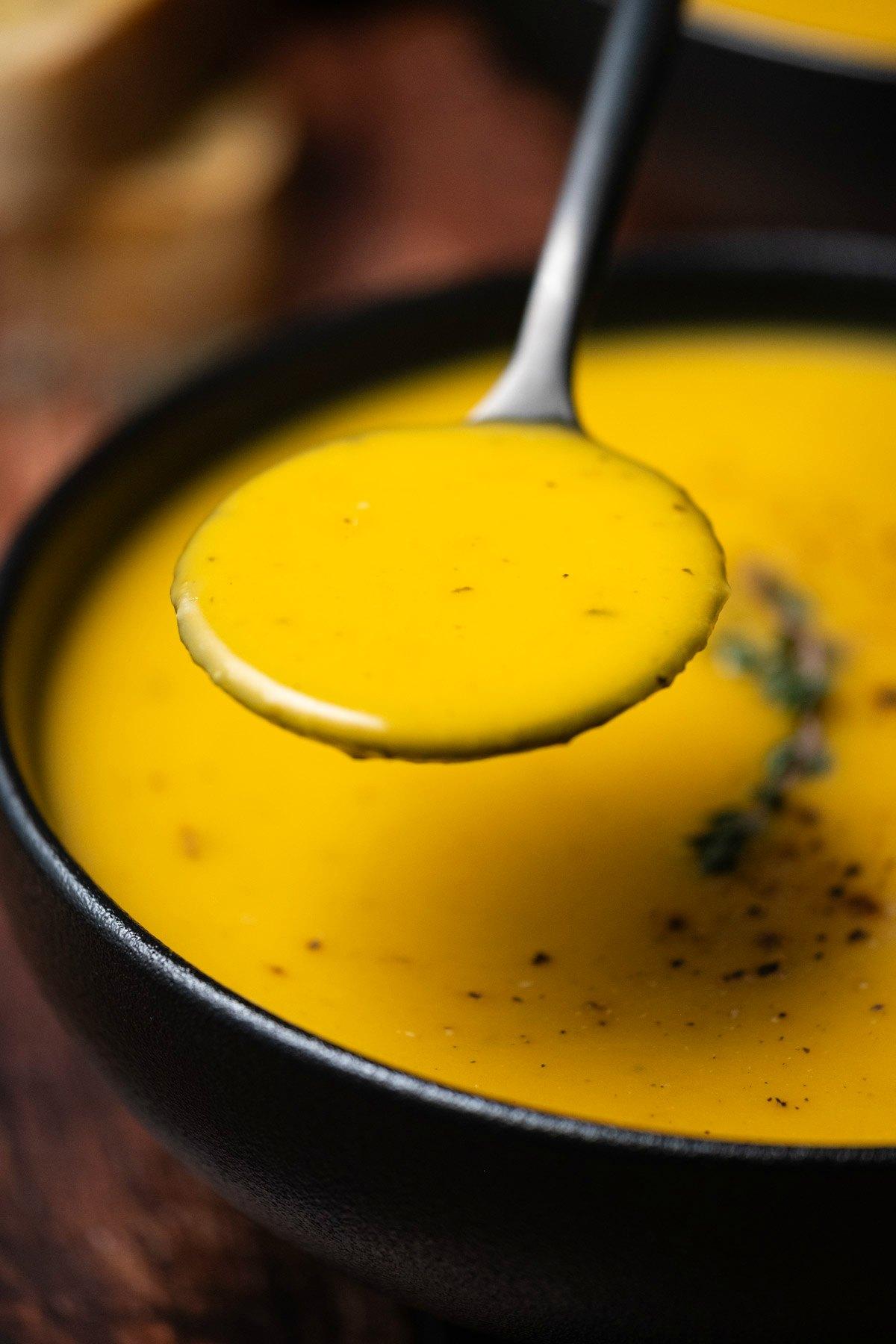 Spoonful of roastd butternut squash soup.