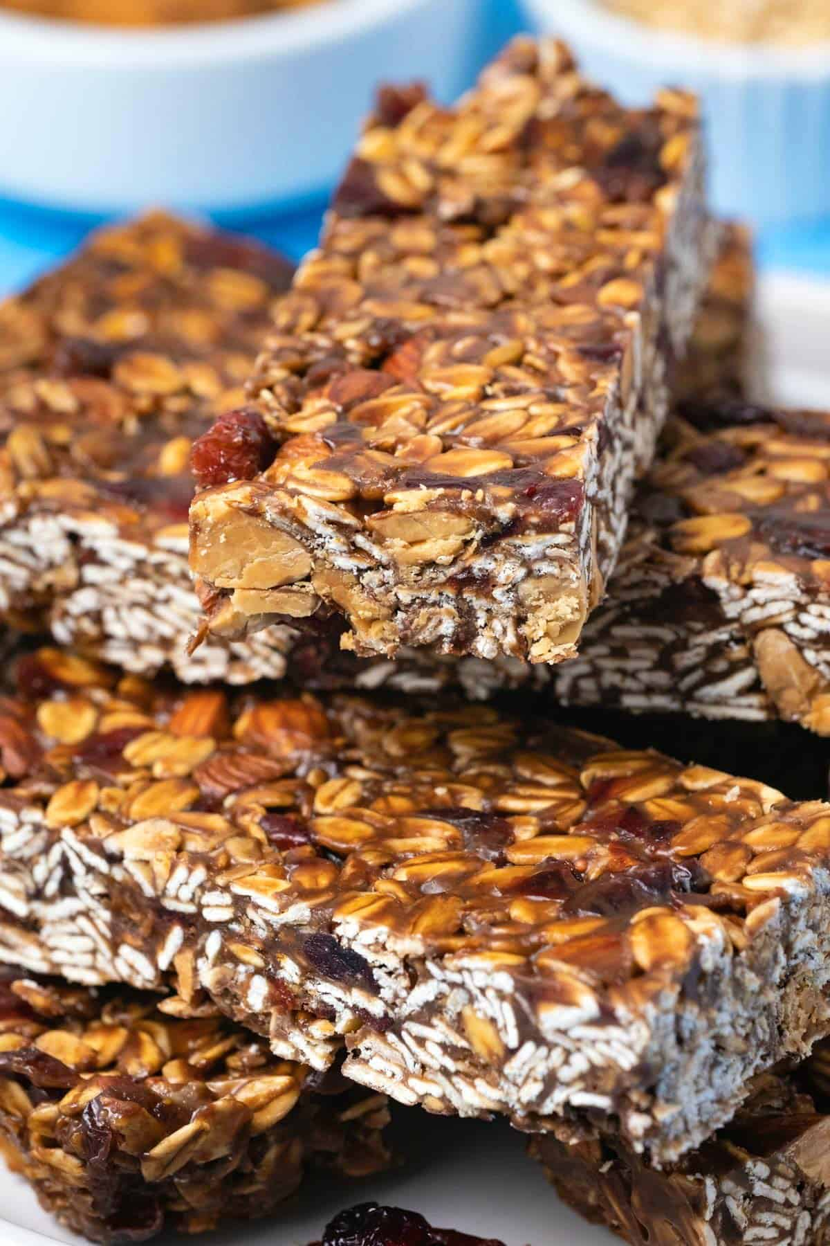 Granola bars stacked up on a white plate.