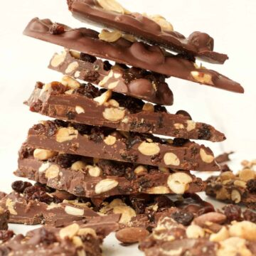 Vegan chocolate bark stacked up on a white plate
