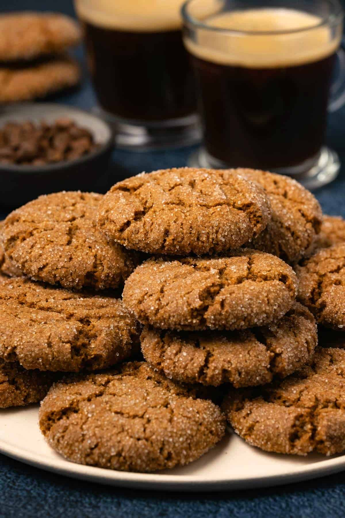 Stack of vegan ginger cookies on a plate.