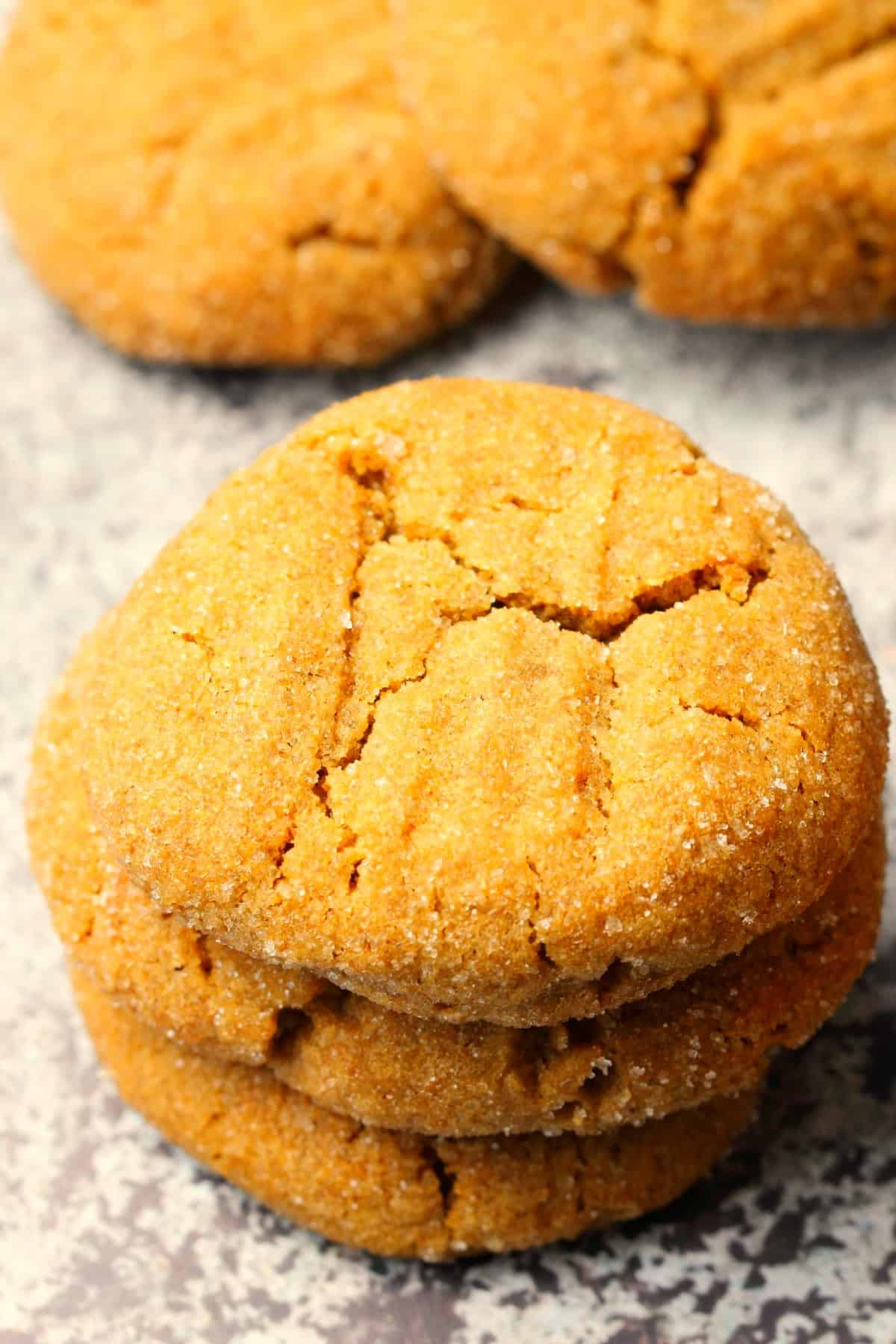 A stack of three molasses cookies.