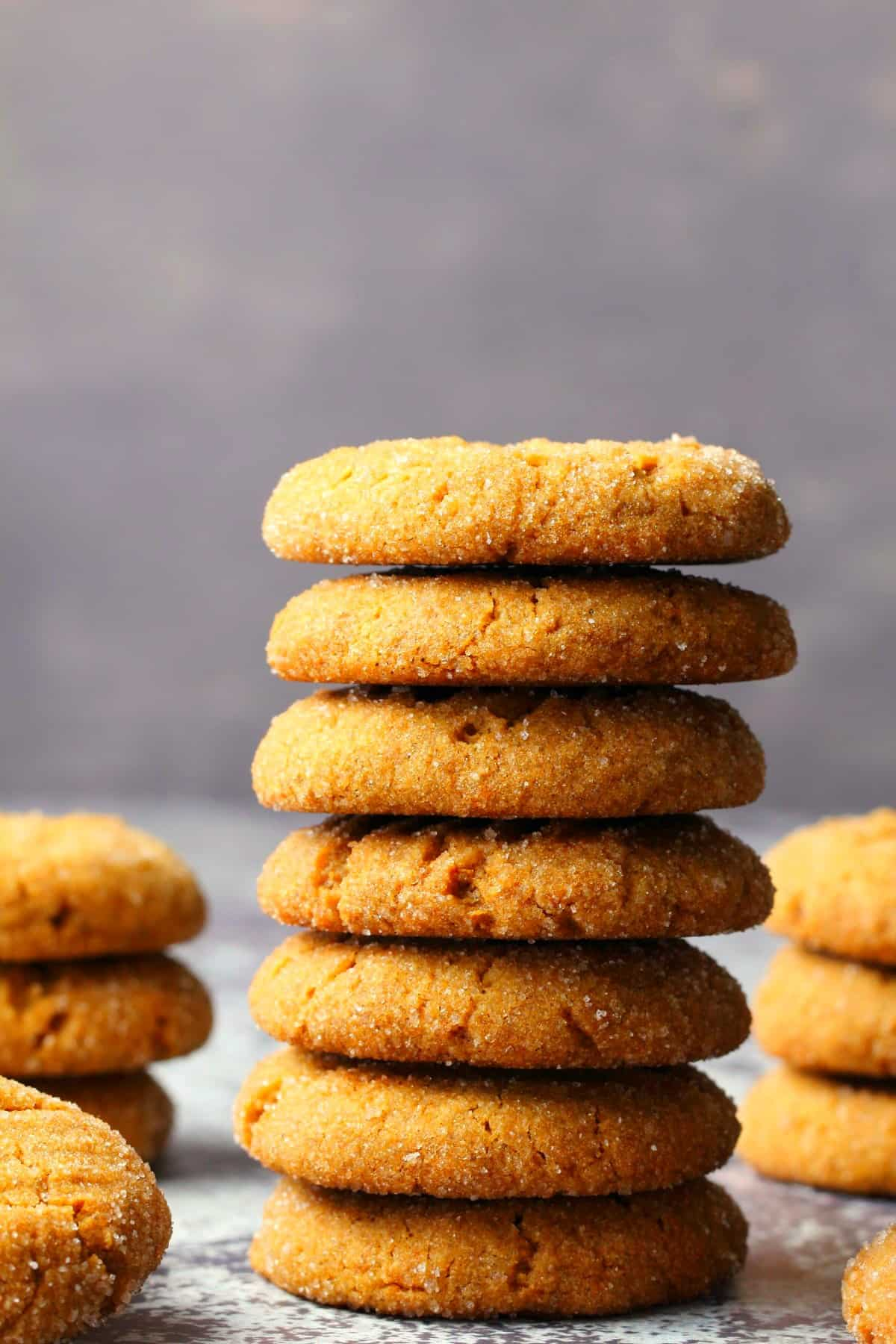 Vegan molasses cookies in a stack.