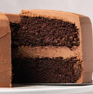 Gluten free chocolate cake on a white cake stand