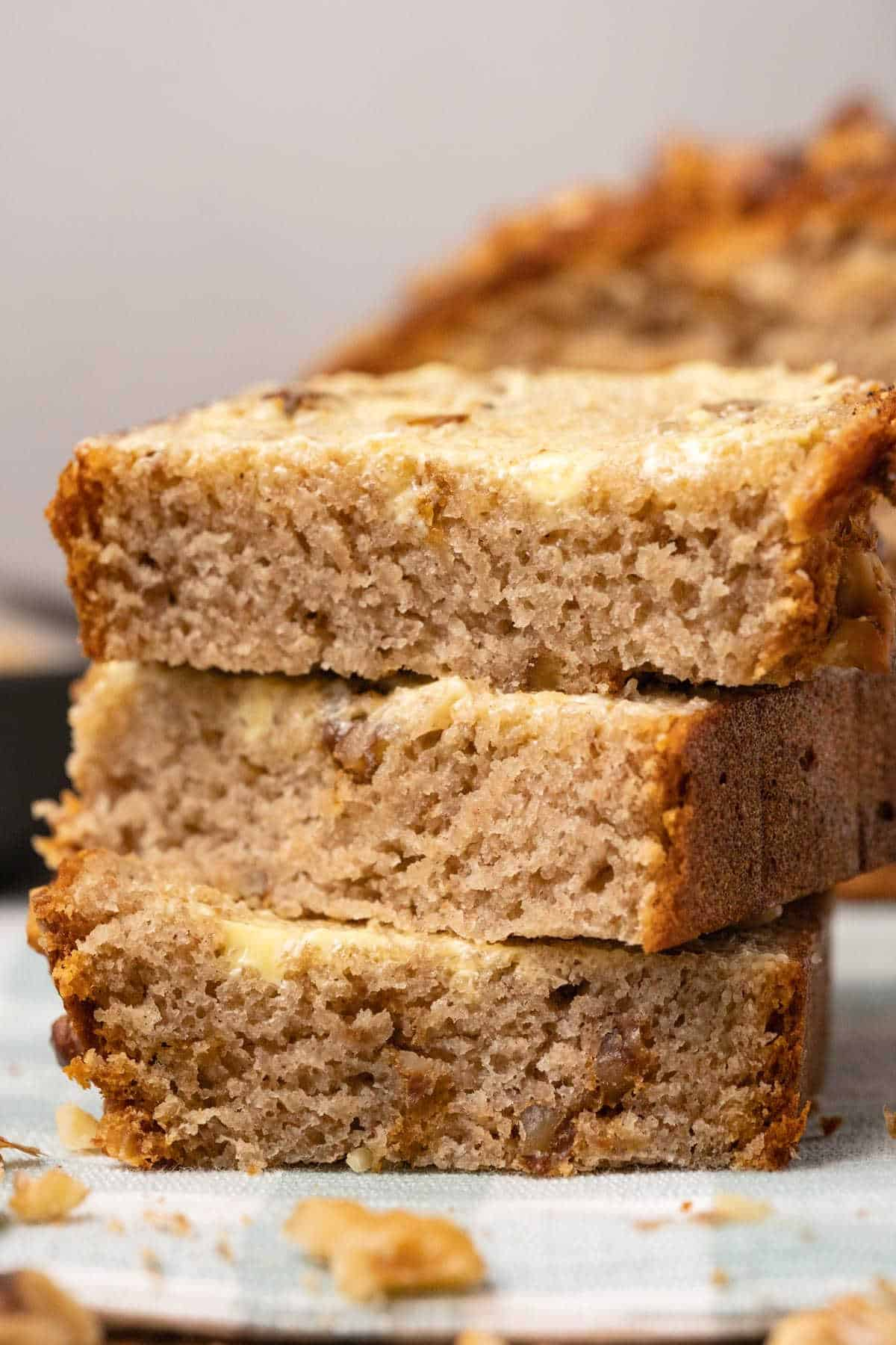 Buttered slices of banana bread in a stack.
