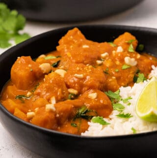 Butternut squash curry in a black bowl