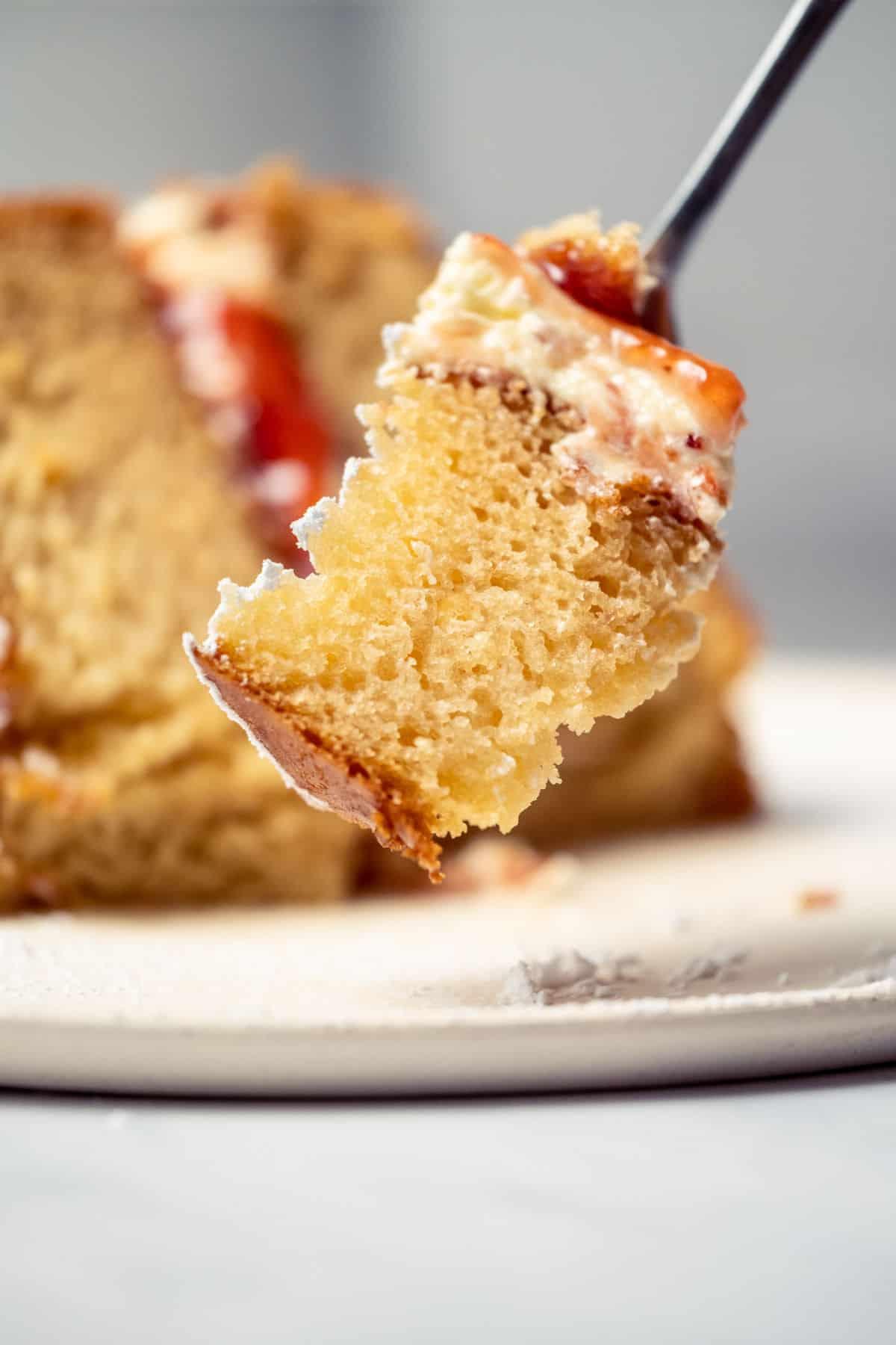 Forkful of vegan Victoria sponge cake.