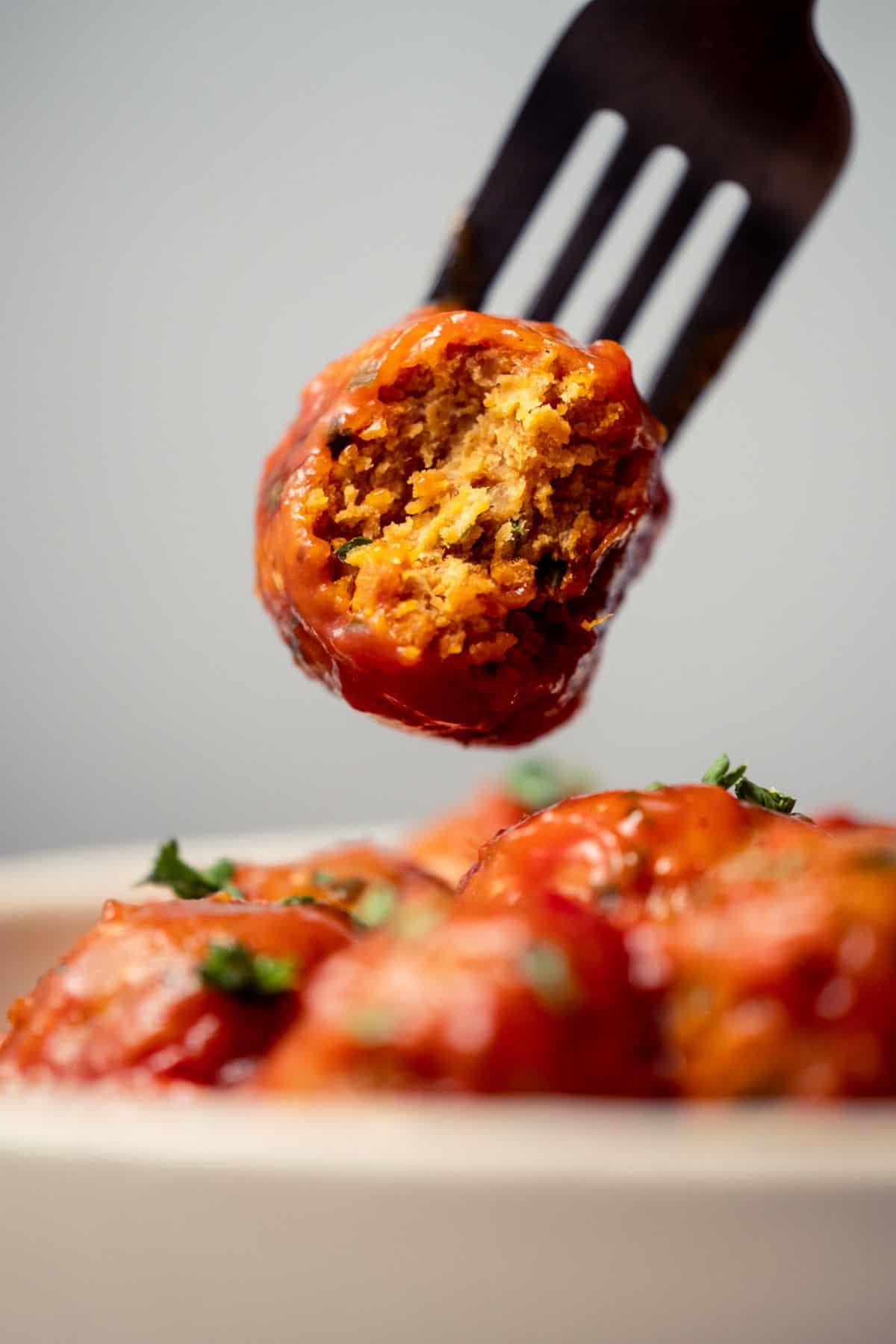 Chickpea meatball on a fork.