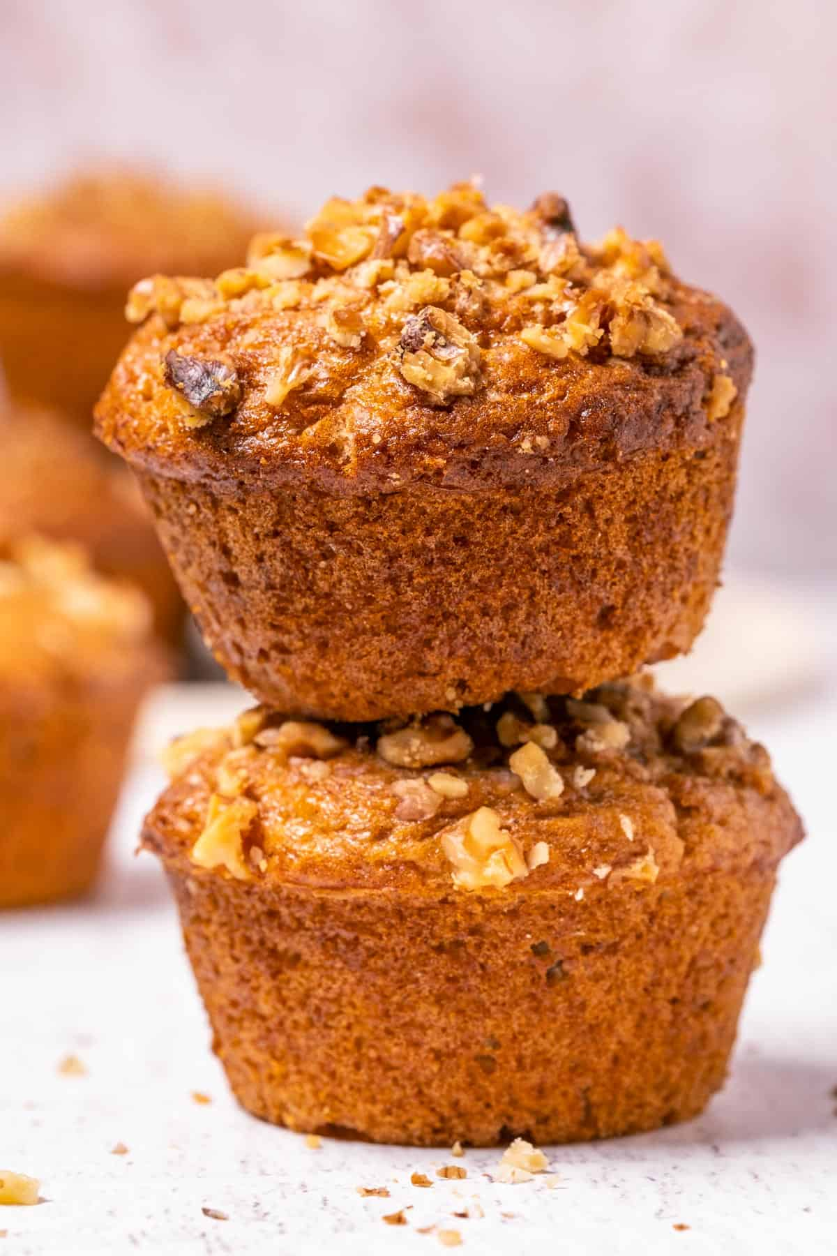 Stack of two banana bread muffins.