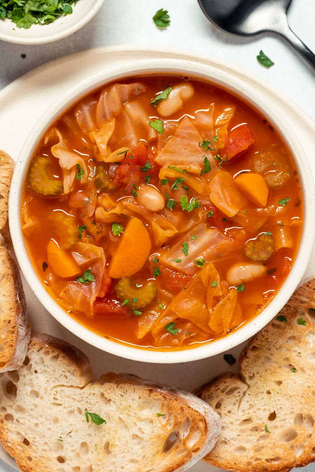 Vegan cabbage soup in a white bowl.