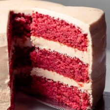Slice of strawberry cake on a cake lifter.