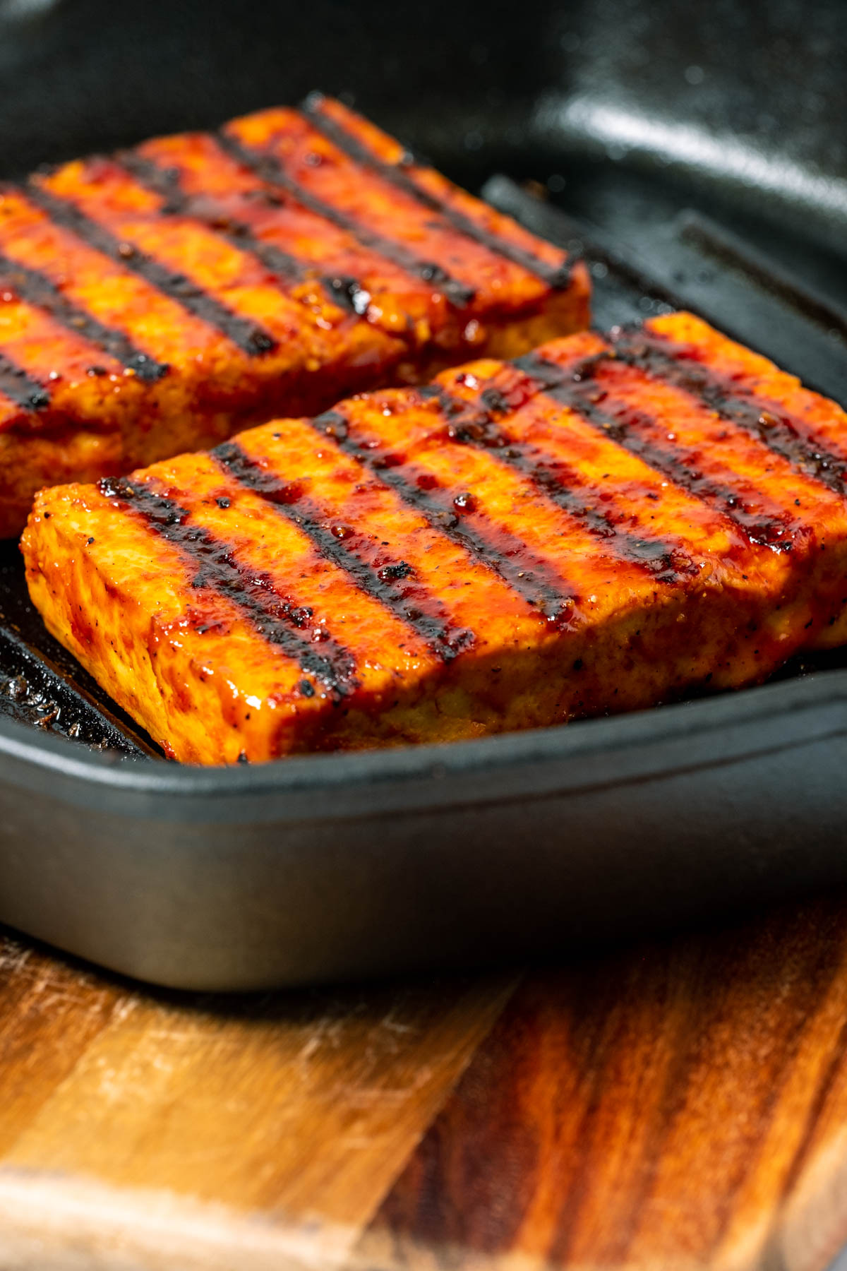 Tofu steaks in a cast iron grill pan.