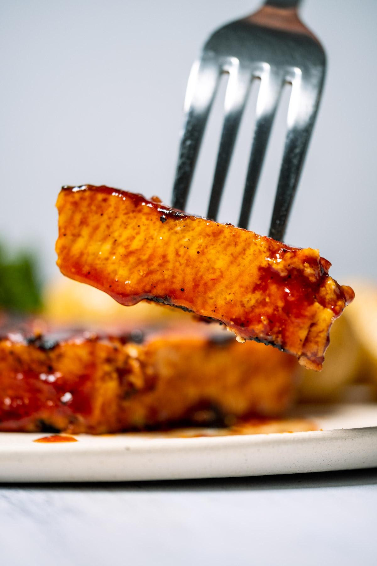 Forkful of tofu steak.