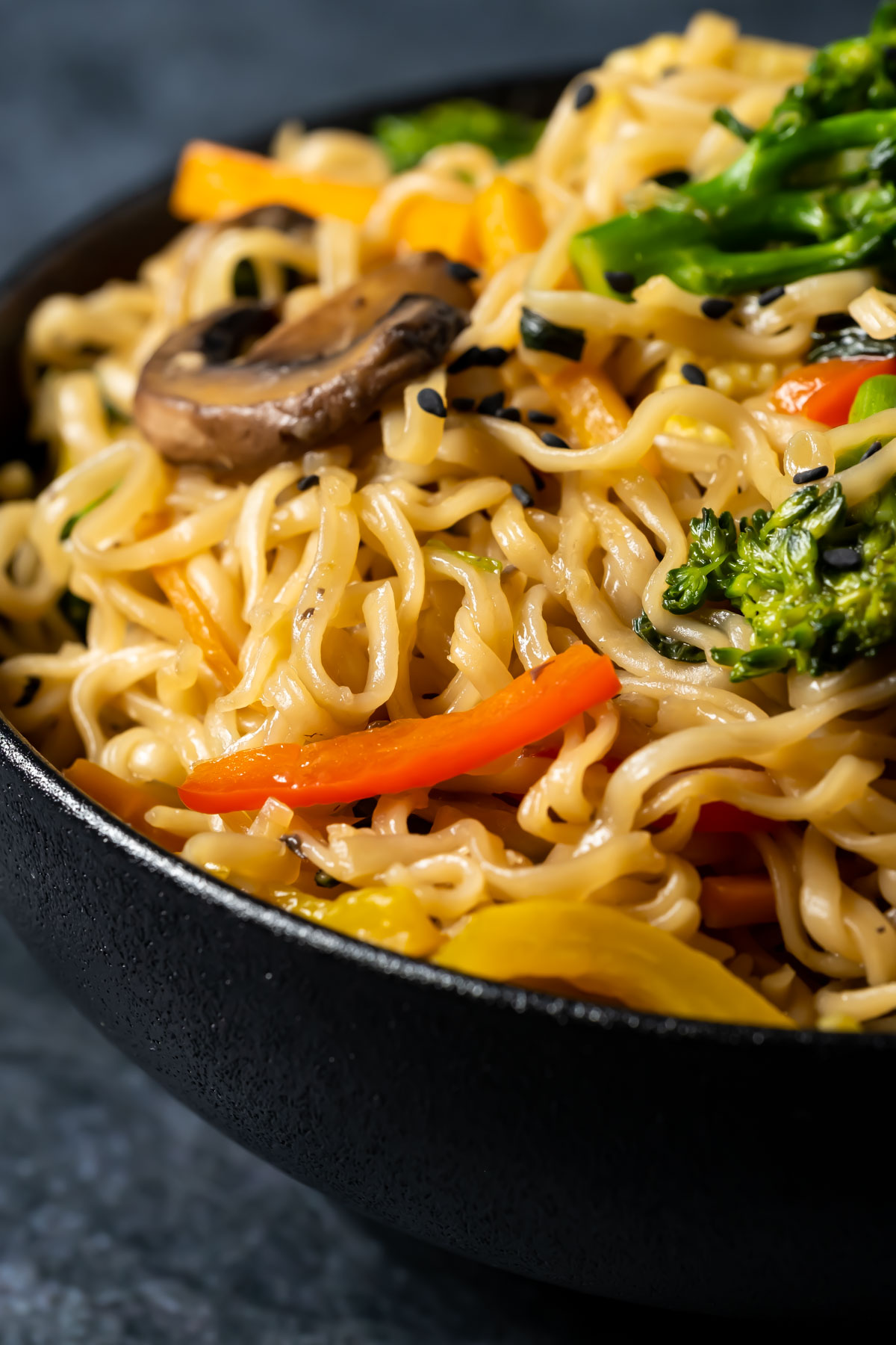 Vegan chow mein in a black bowl.