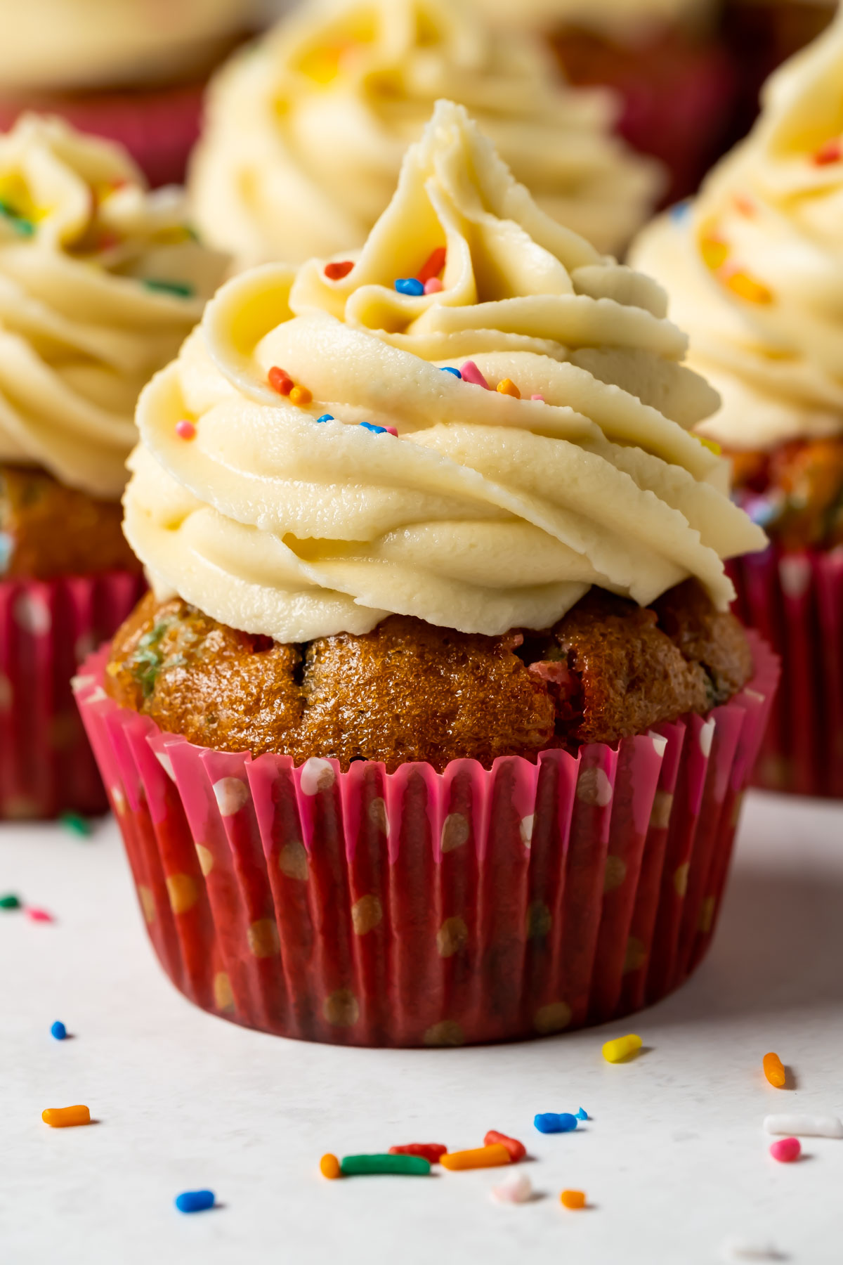 Vegan funfetti cupcakes on a white plate.