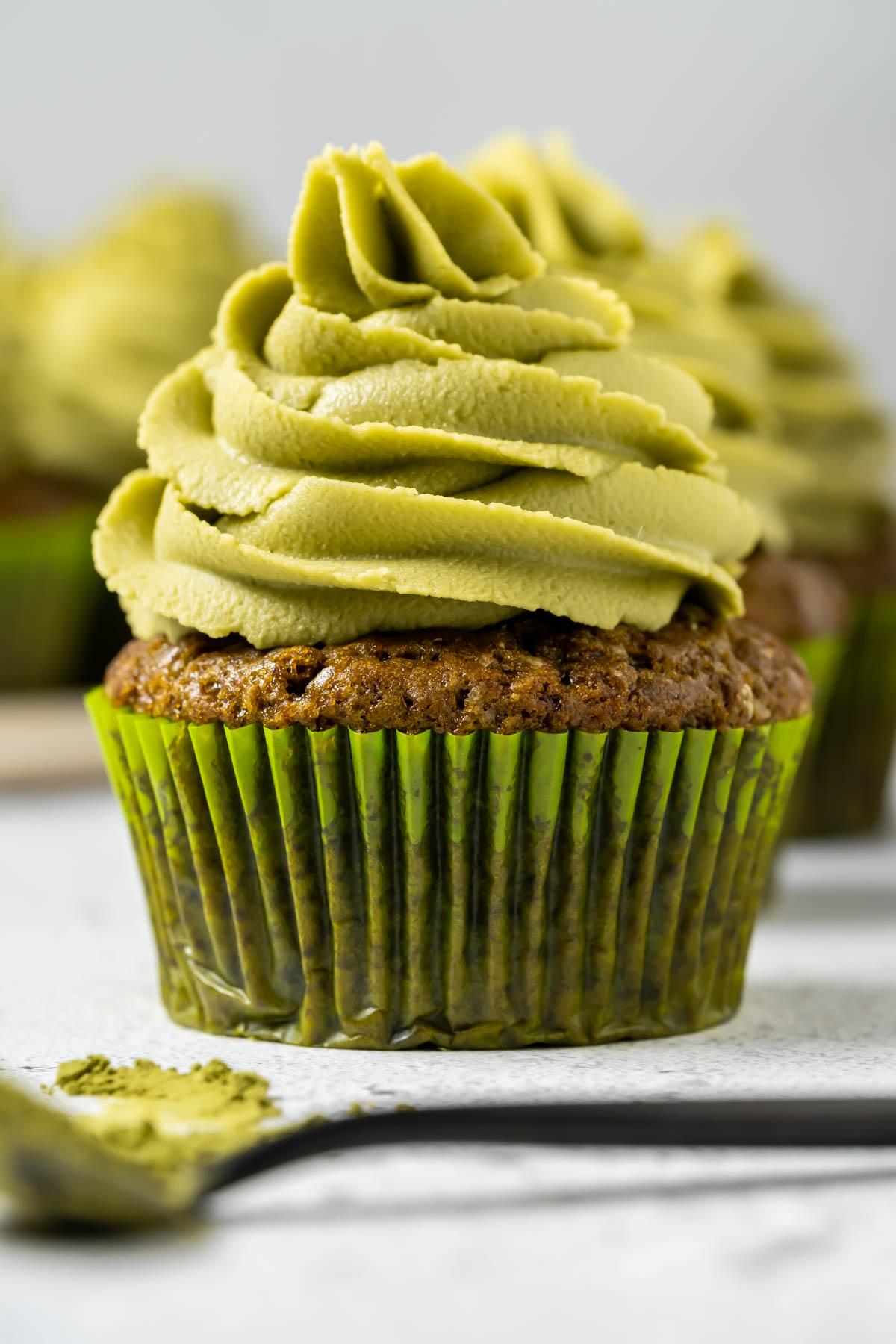 Vegan matcha cupcakes on a white plate.