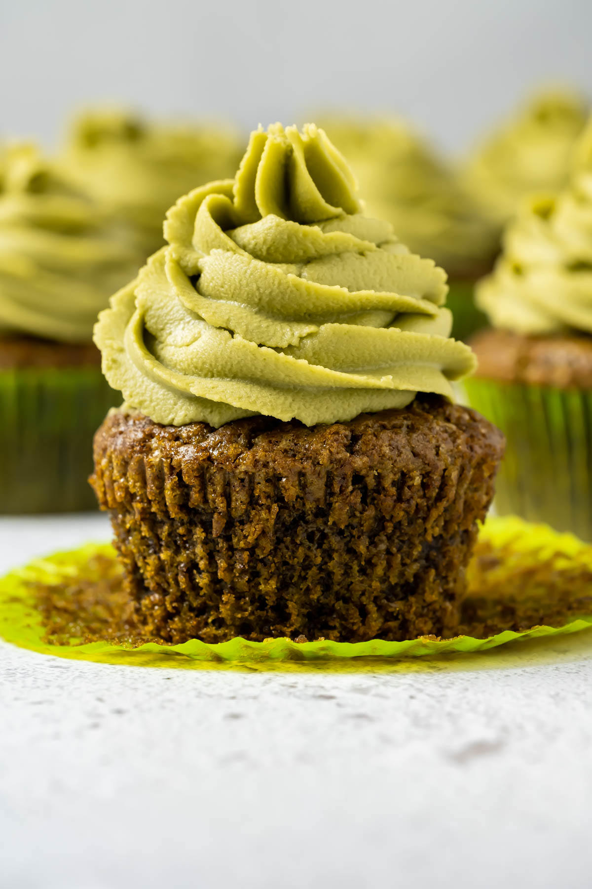 Matcha cupcake with the liner pulled down.