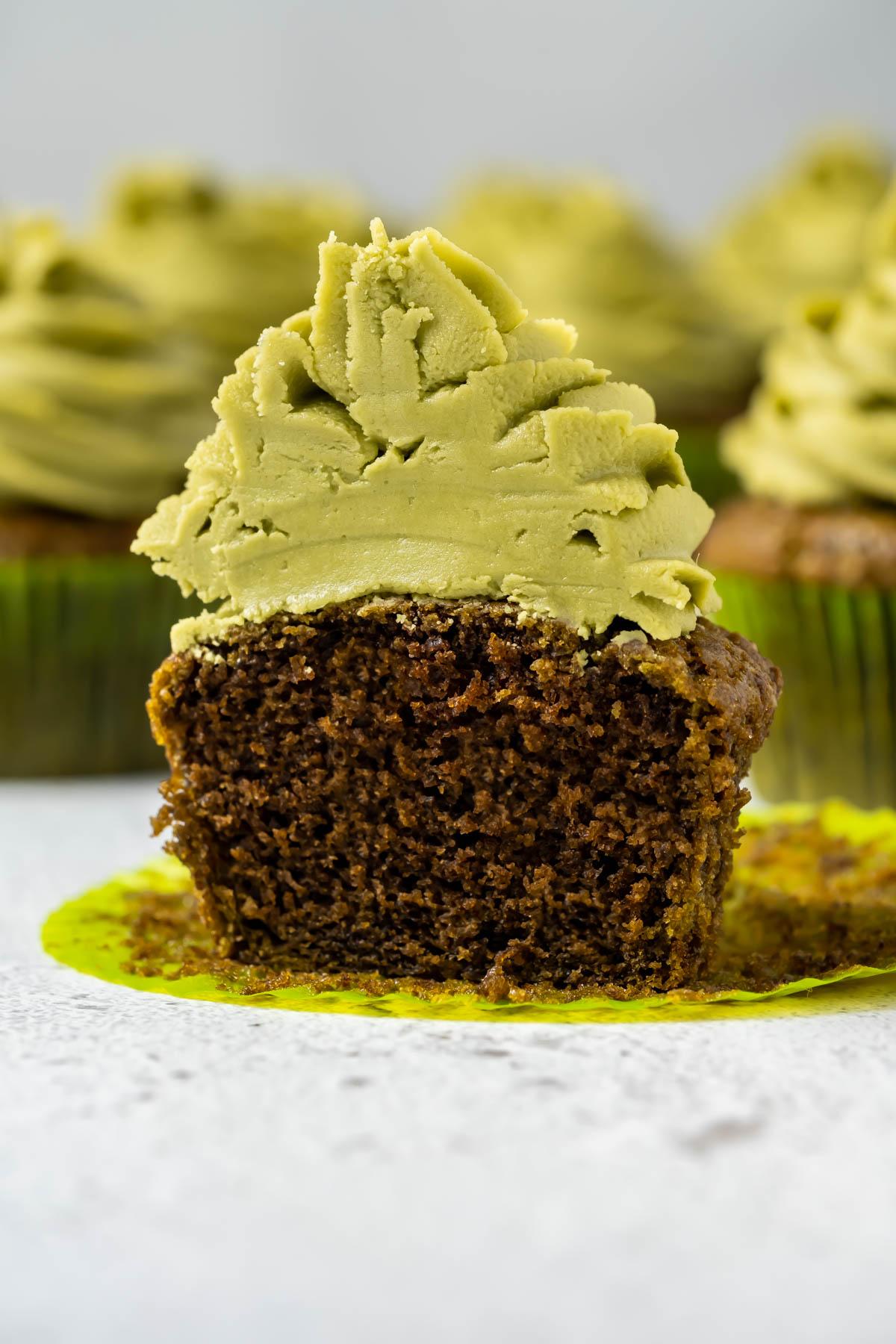 Vegan matcha cupcake cut in half.