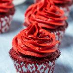 Vegan red velvet cupcakes in a row.