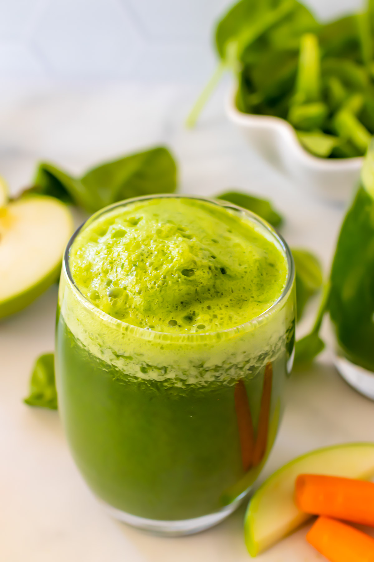 A glass of green juice.