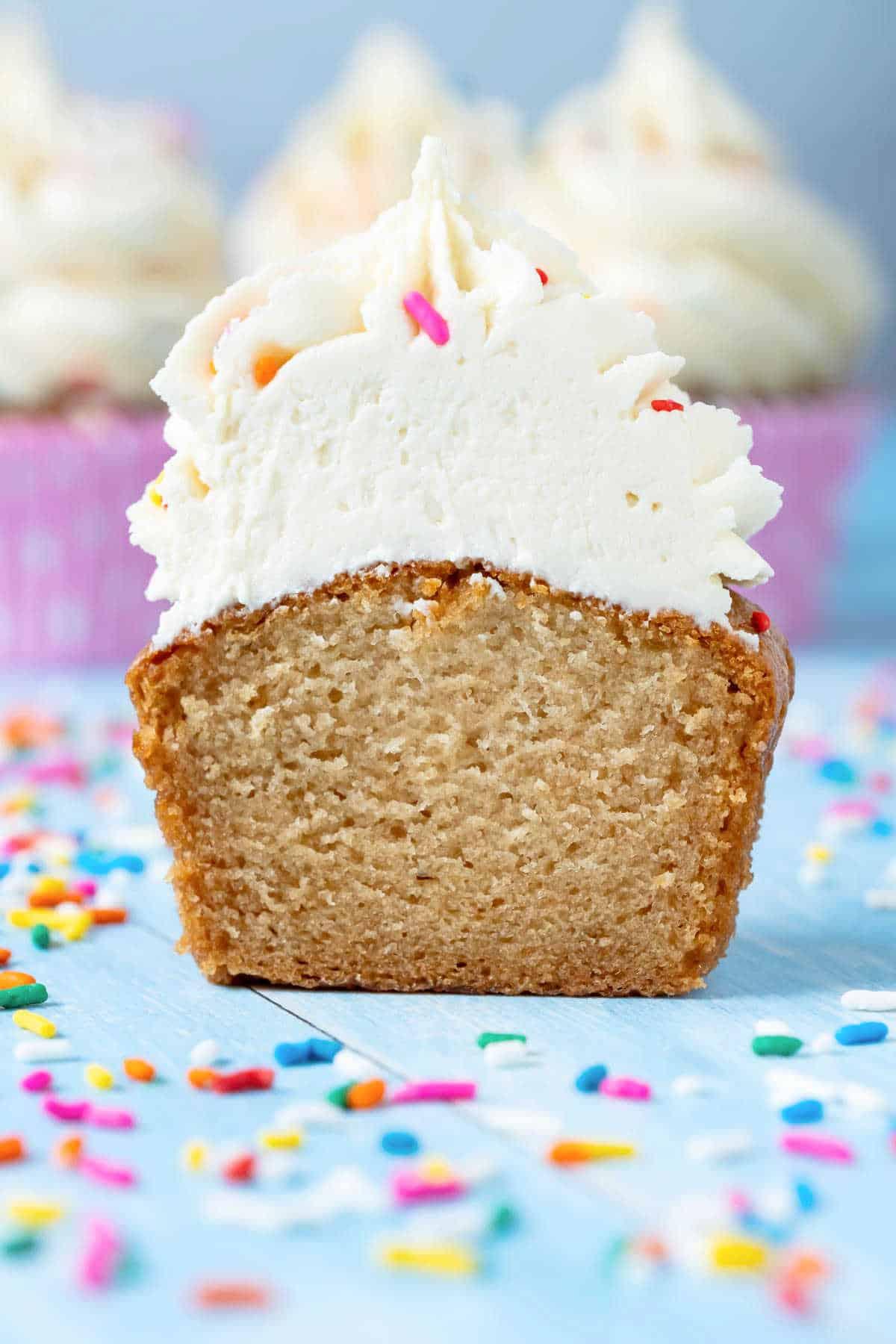 Vegan gluten free vanilla cupcake cut in half to show the center.