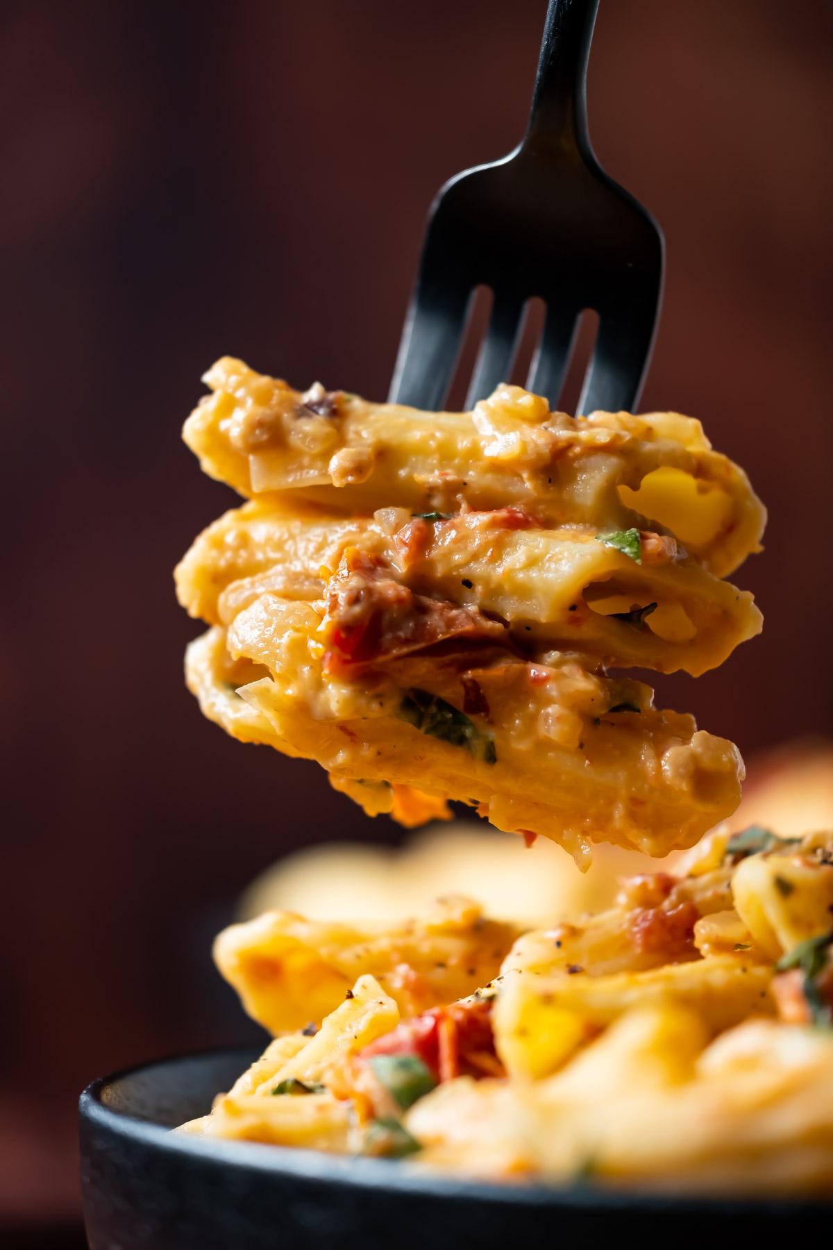 Forkful of hummus pasta.