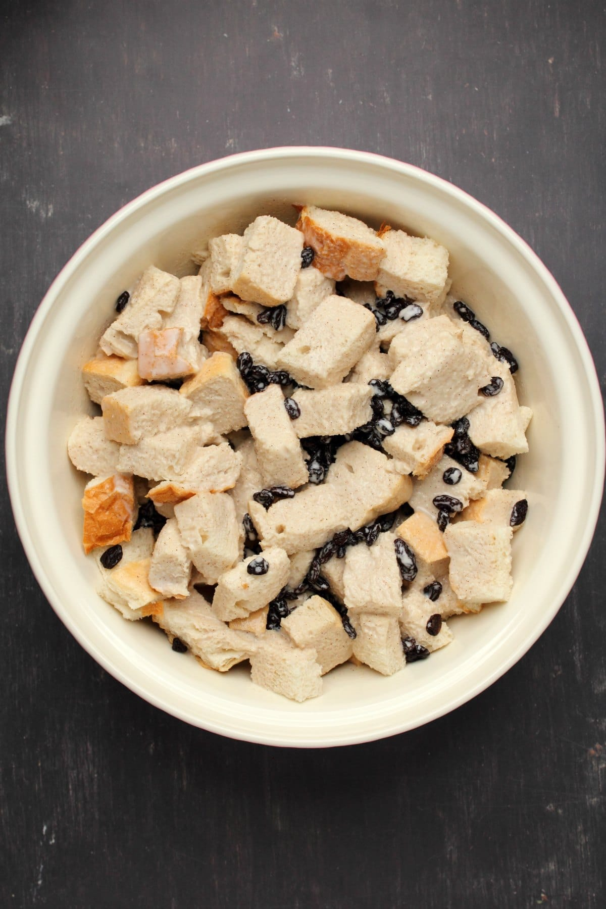 Blended mix poured over bread and raisins in mixing bowl and tossed.