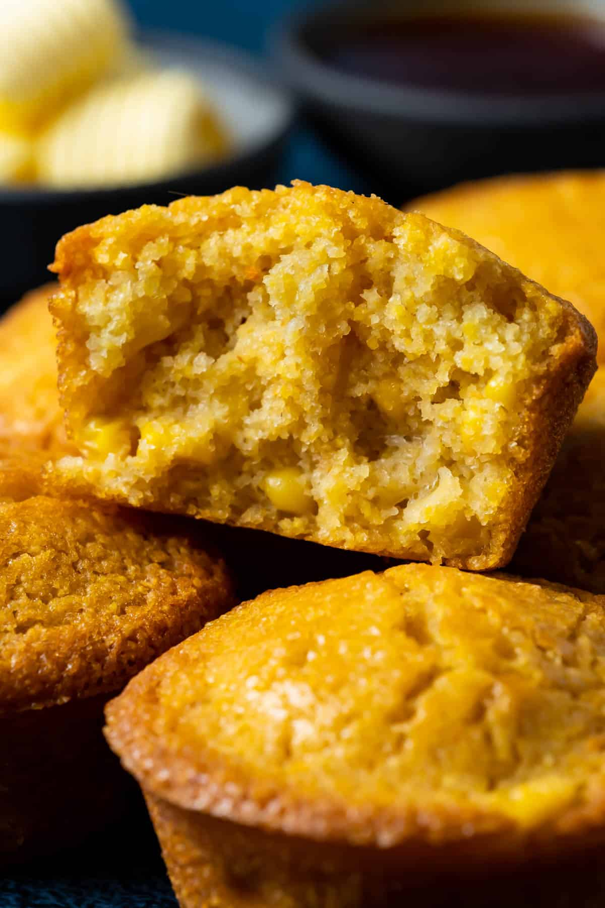 Vegan cornbread muffin broken in half.