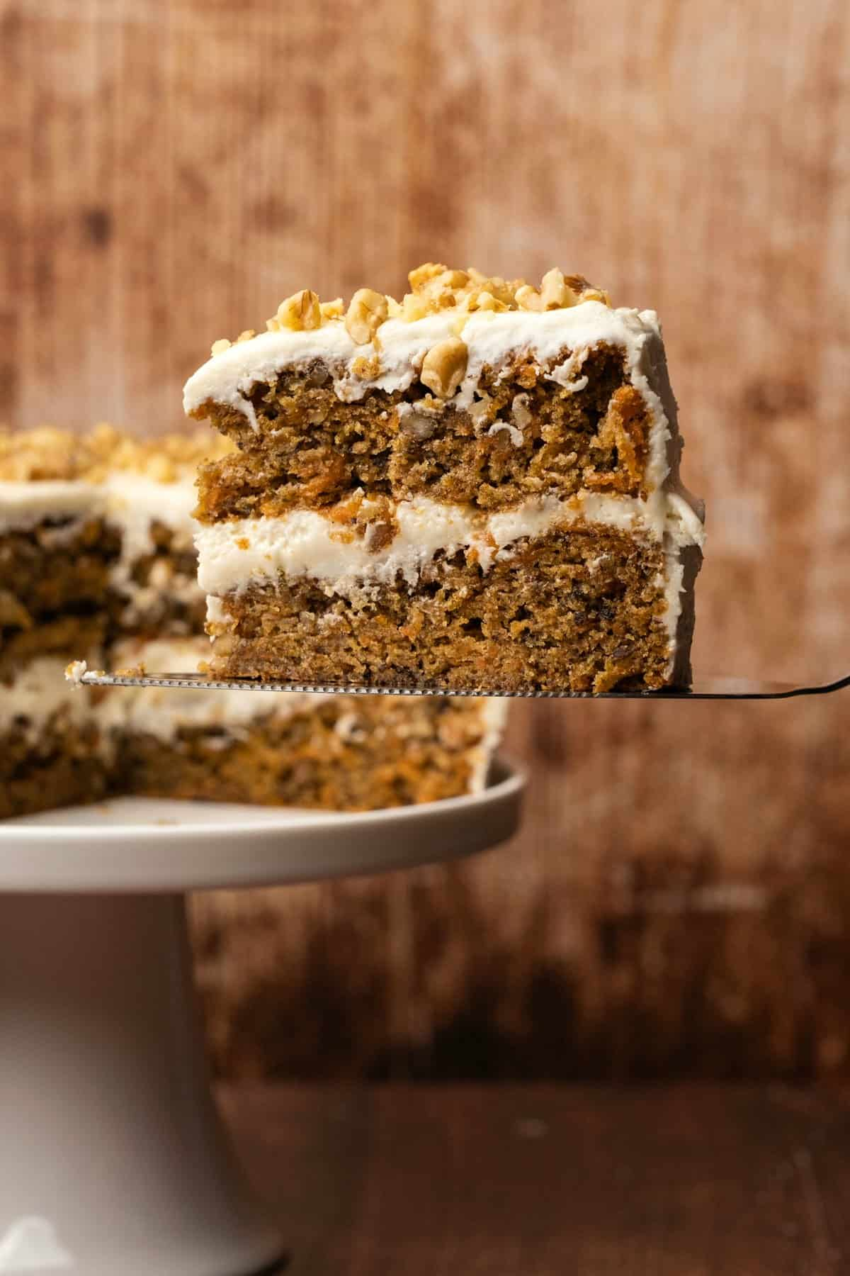 Slice of vegan carrot cake on a cake lifter.
