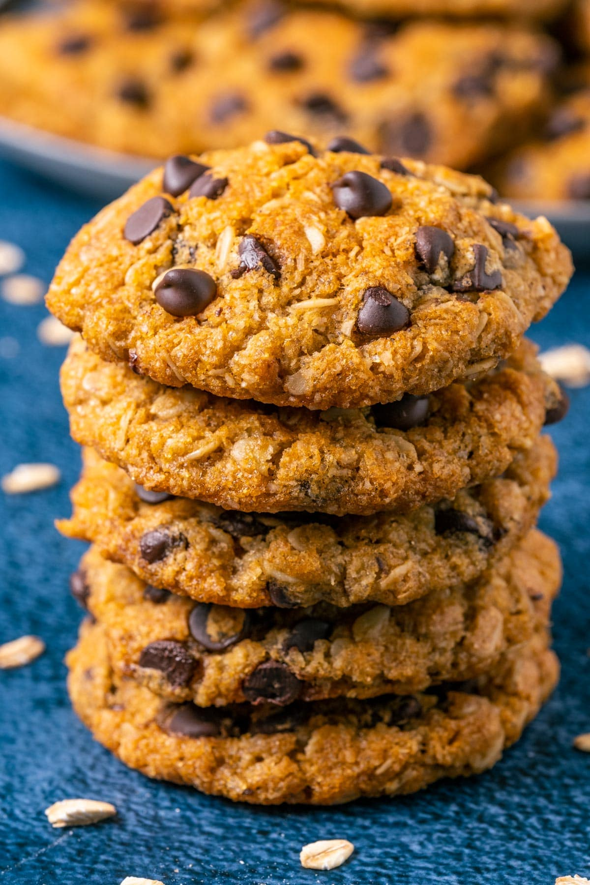 Stack of vegan oatmeal chocolate chip cookies.