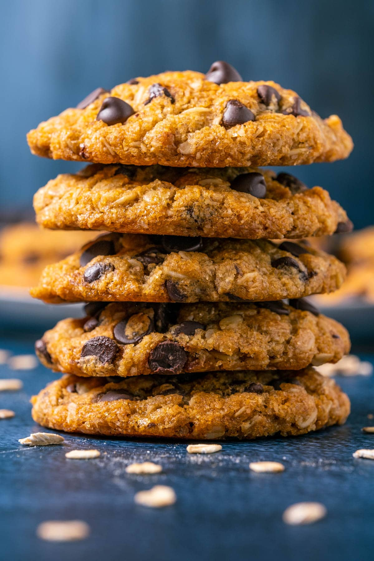 Five oatmeal chocolate chip cookies in a stack.