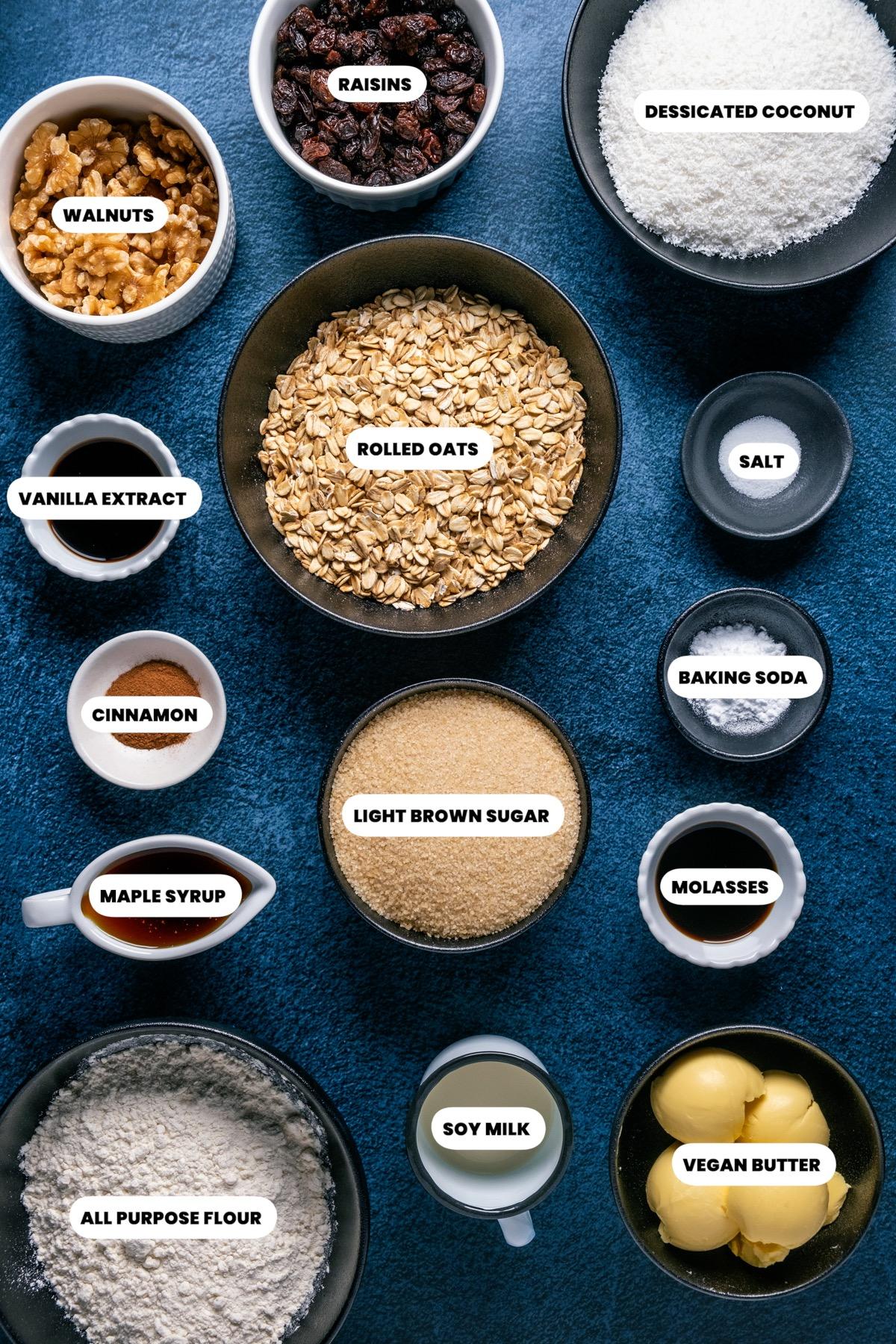 Photo of the ingredients needed to make vegan oatmeal raisin cookies.